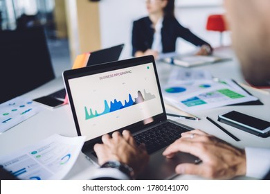 Cropped image of male analyst browsing business infographics during working process with statistics online report on laptop computer, trader checking web graphic charts via dashboard app on netbook - Shutterstock ID 1780141070