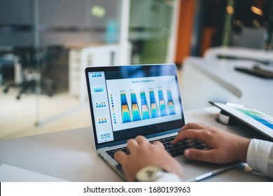Cropped image of male entrepreneur checking online financial report with revenue infographics connecting to 4g on laptop for doing digital marketing, businessman analyzing diagram of monetary gain