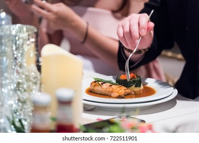 Cropped image of man eating in restaurant