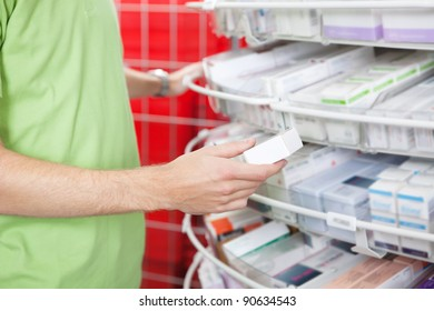 Cropped image of man holding medication box at pharmacy