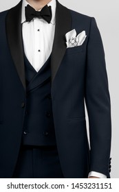 cropped image of a man in a men's suit. isolated on grey background. front view