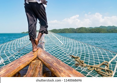 Cropped image of the man in a pirate costume on the old sailing ship. Concept of freedom and adventures.