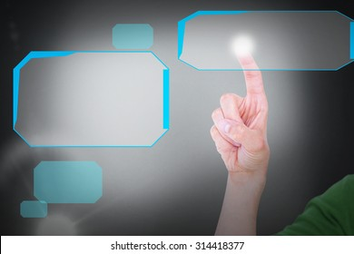 Cropped image of man touching an invisible screen against grey background