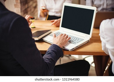 Cropped Image Of Man's Hand Typing On Laptop. Right-Side View Of Businessman Working On His White Stylish Laptop.