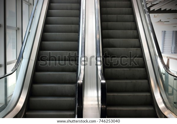 Cropped image of old escalator. Selective focus and shallow depth of field.