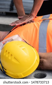 Cropped image of a paramedic's hands providing cardiopulmonary resuscitation (CPR) on a construction worker injured in an accident at work