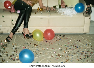 Cropped image of party girl sitting on sofa