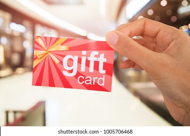 Cropped Image Of Person's Hand Holding Gift Card
