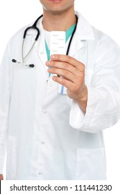 Cropped image of physician displaying medicine pack in front of camera