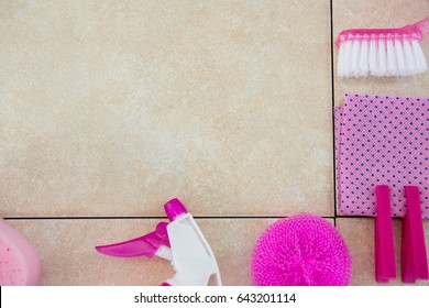 Cropped image of pink cleaning equipment on tiled floor