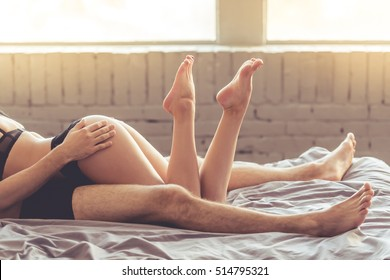 Cropped image of sensual beautiful young couple having sex on bed