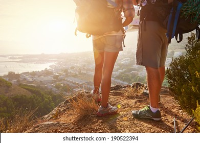 Cropped image of two hikers legs standing on a hiking path and looking at the view