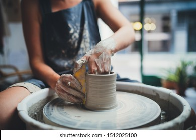 Cropped Image of Unrecognizable Female Ceramics Maker working with Pottery Wheel in Cozy Workshop Makes a Future Vase or Mug, Creative People Handcraft Pottery Class