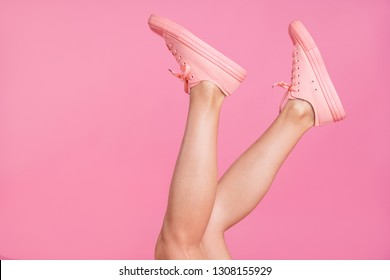 Cropped image view photo of nice attractive feminine girlish fit slim clear shaven legs active sport walk go steps trendy fasionable foot-wear isolated over pink pastel background