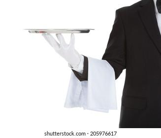 Cropped image of waiter holding empty tray over white background