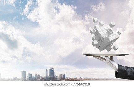 Cropped image of waiter's hand in white glove presenting multiple cubes on metal tray with cityscape view on background. 3D rendering.