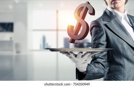 Cropped image of waitress's hand in glove presenting stone dollar symbol on metal tray with office view on background. 3D rendering.