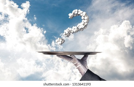 Cropped image of waitress's hand in white glove presenting multiple cubes in form of question mark on metal tray with cloudy skyscape on background.