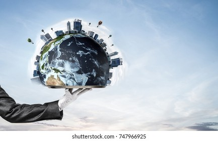 Cropped image of waitress's hand in white glove presenting Earth globe on metal tray with cloudy skyscape on background. 3D rendering. Elements of this image are furnished by NASA.