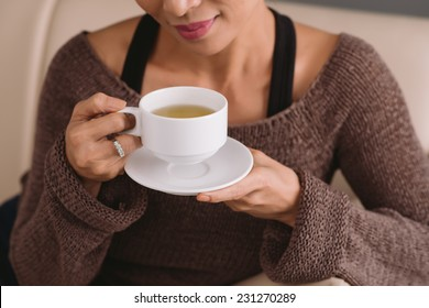 Cropped image of woman drinking tea