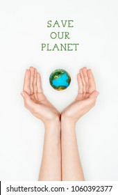 cropped image of woman holding earth model with sign save our planet isolated on white, earth day concept