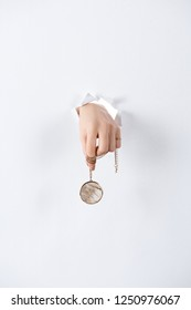 cropped image of woman holding hand with beautiful luxury round locket with marble through white paper