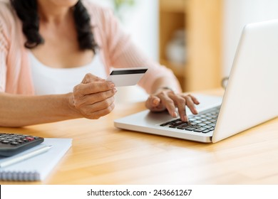 Cropped image of woman inputting card information while shopping online
