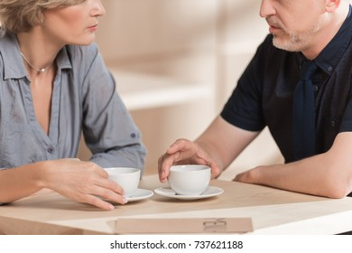 Cropped image of Woman and man drinking coffee at cafe