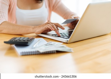 Cropped image of woman paying her bills online, selective focus