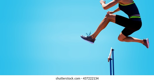 cropped image of woman practicing show jumping against blue background