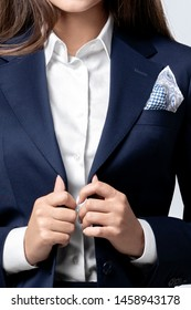 cropped image of a woman in a women's suit in a studio. closeup isolated on grey background