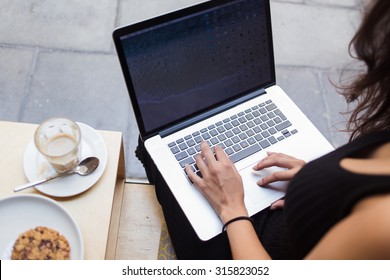 Cropped image of woman's hands typing text on laptop keyboard during coffee break, young female working on net-book with blank copy space screen for your text message or advertising concept