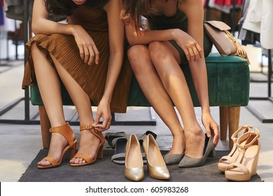 Cropped image of women choosing the best shoes