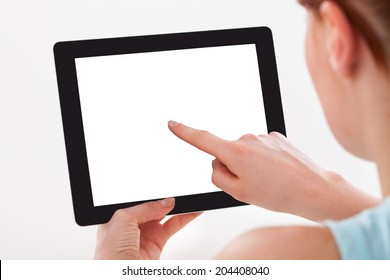 Cropped image of young woman using digital tablet over white background