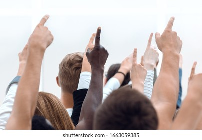 cropped image of a youth group pointing up.