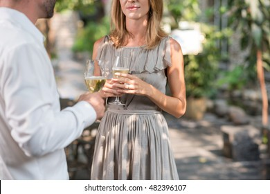 Cropped imaged of people drinking and chatting at party