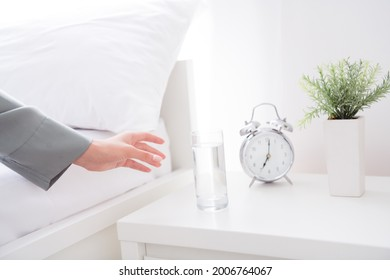 Cropped photo of charming pretty young woman hand gray nightwear waking up drinking water glass indoors house home room