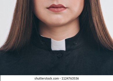 cropped photo: close-up of clothing items. Priest's robe: collar