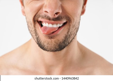 Cropped photo closeup of funny naked man grimacing at camera with sticking out his tongue isolated over white background