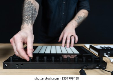 Cropped photo hands of creativity disc jockey with tattoo. Han records music inside house room studio with black dark wall interior
