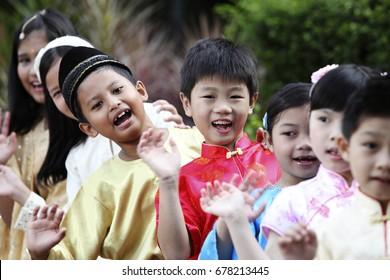 Cropped photo of multiracial kids waiving at camera