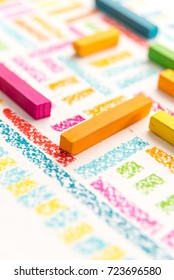 Cropped photo of pastels chalks on colorful background, selective focus