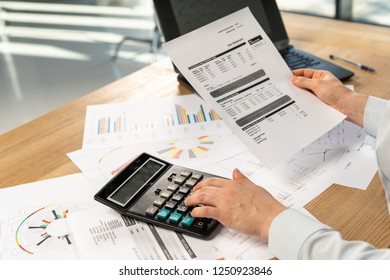 Cropped photo of secretary hands accounting advisor employee employer employment entrepreneur lady in her formalwear shirt she sit behind desk in light loft interior check cost tax