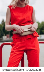 a cropped photo of a waist bag that is fixed to the girls at the waist, urban clothing style. Street photography