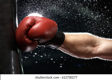 Cropped photo of young strong sports man boxer make exercises in gym