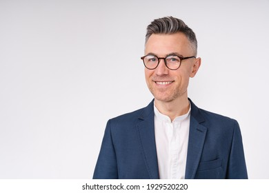 Cropped portrait of a handsome mature businessman in glasses isolated over white background