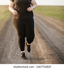 Cropped portrait of overweight runner go jogging outdoors. Weight losing, sports, healthy lifestyle