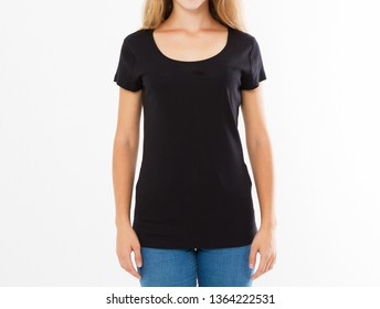 Cropped portrait of young blond woman with beautiful slim body wearing black T-shirt with copy space for your text or advertising content. Close up of fashionable teenager trying on new clothing