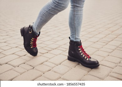 Cropped profile photo of fit lady legs tiptoe wear stylish black leather shoes boots denim jeans go walk road