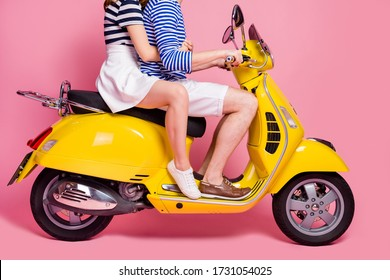 Cropped profile side view portrait of his he her she nice attractive lovely couple riding moped embracing spending weekend vacation journey isolated on pink pastel color background